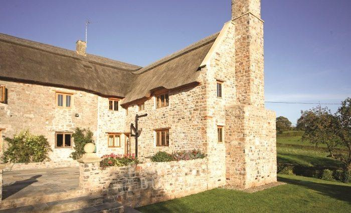 Oak frame house with stone walls