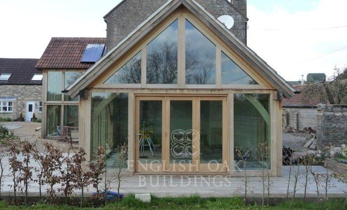 Green Oak Extensions with Direct Glazing and bi-fold oak door