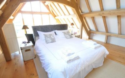Rest your head within the beauty of an oak framed bedroom