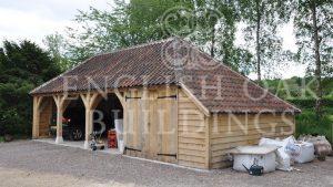 Four bay oak frame garage with workshop