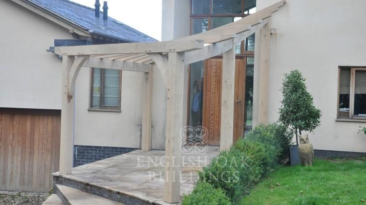 Oak-framed-entrance-pergola-with-a-compound-twist-design1-755x424